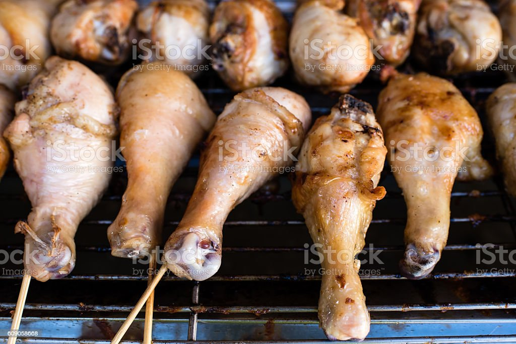 charcoal grilled chicken drumstick sold on street stock photo