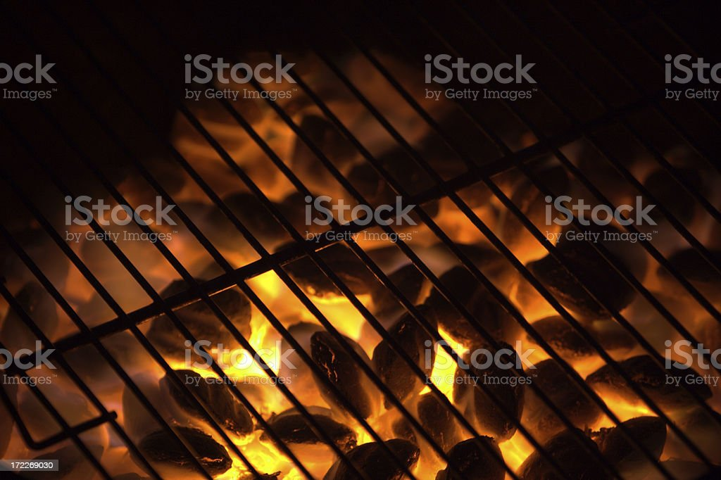 Charcoal on fire in a BBQ grill. stock photo
