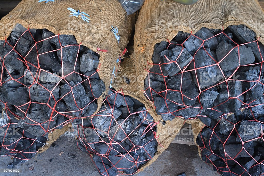 Charcoal packed in sacks stock photo