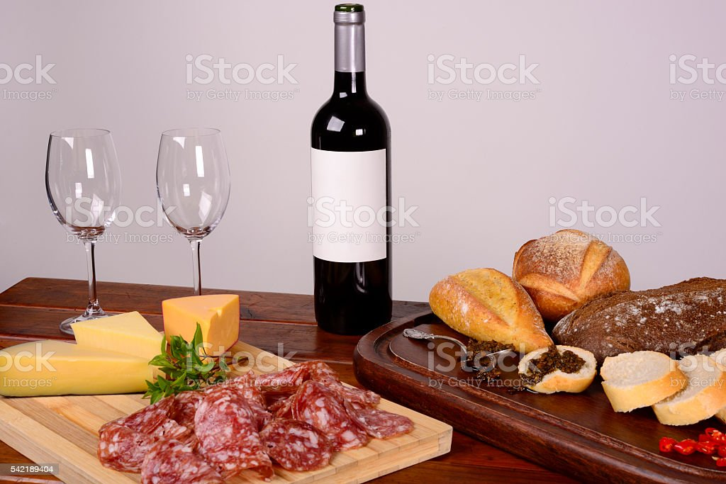 Charcuterie and Cheese Platter, Bread, Chimichurri and Red Wine stock photo