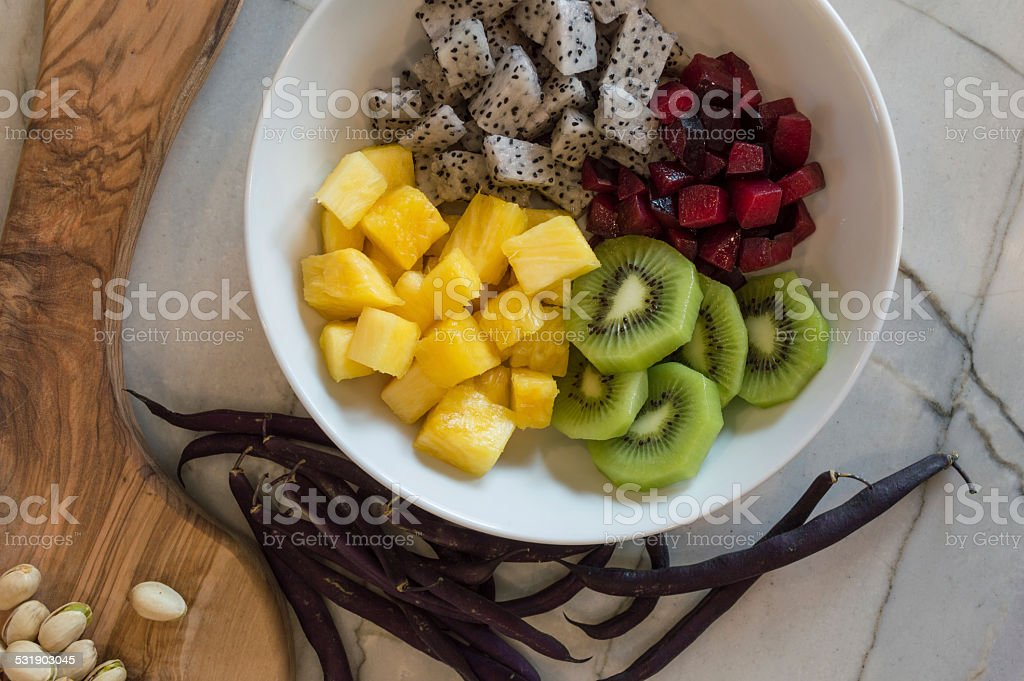 Charcuterie board and fruit bowl stock photo