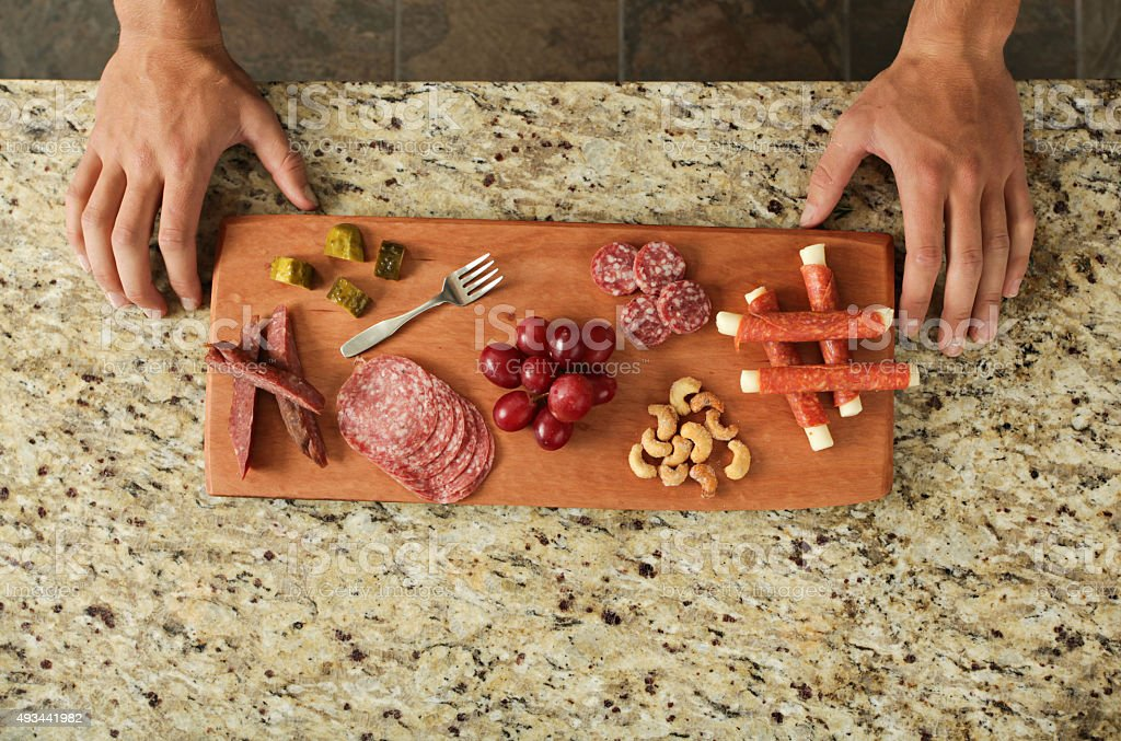Charcuterie board full of meats stock photo