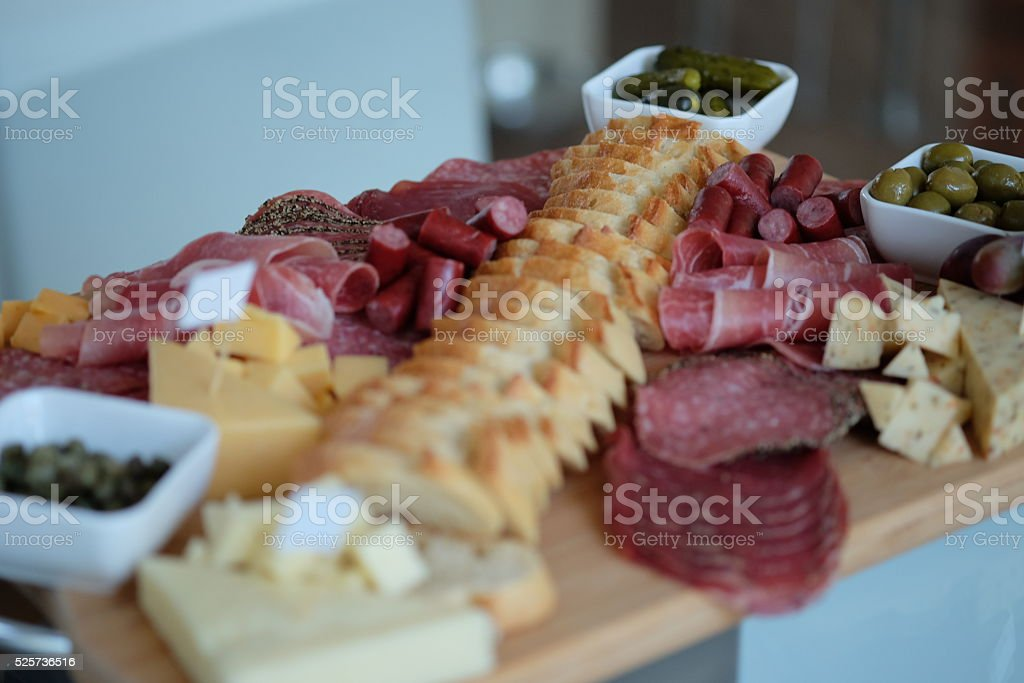 Charcuterie meat and cheese board. stock photo
