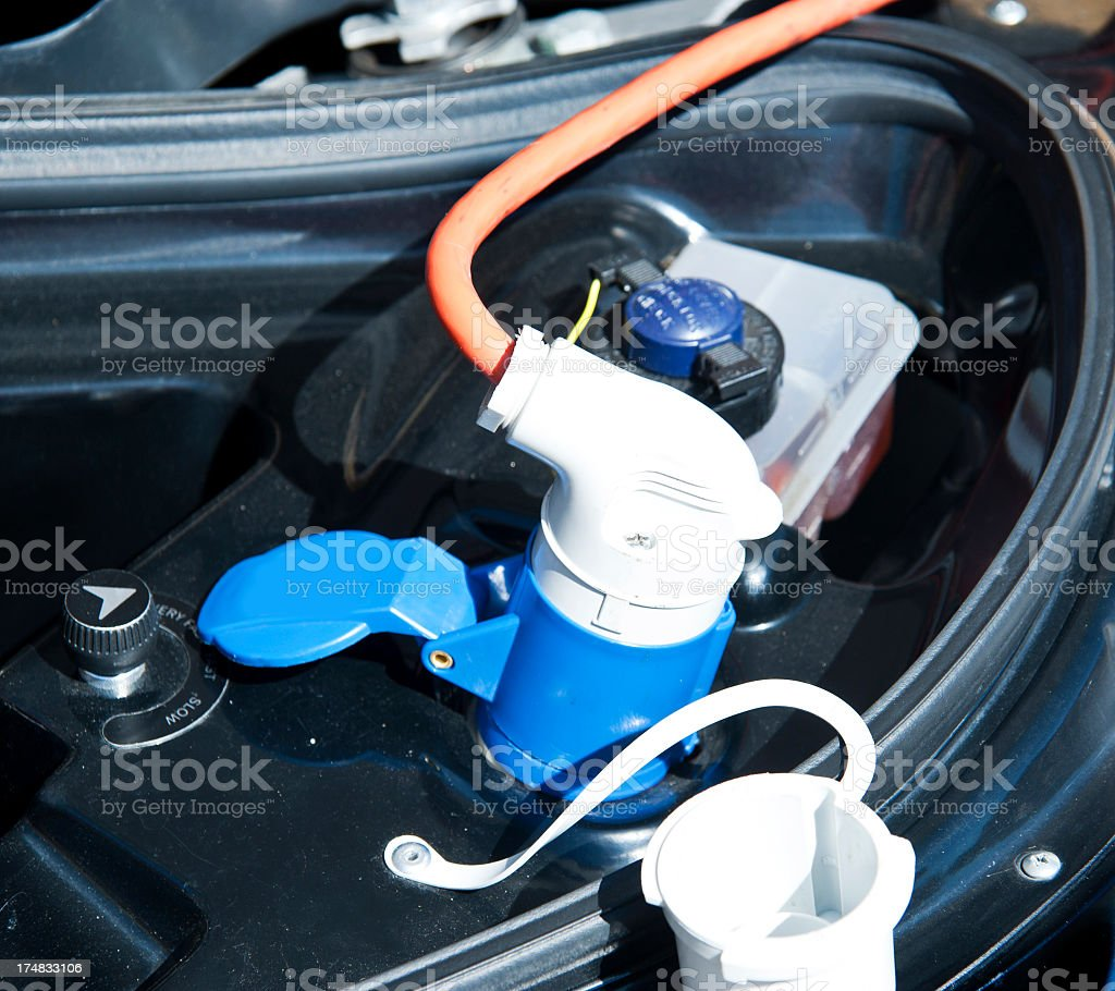 charge electric car outdoor - Elektroauto royalty-free stock photo