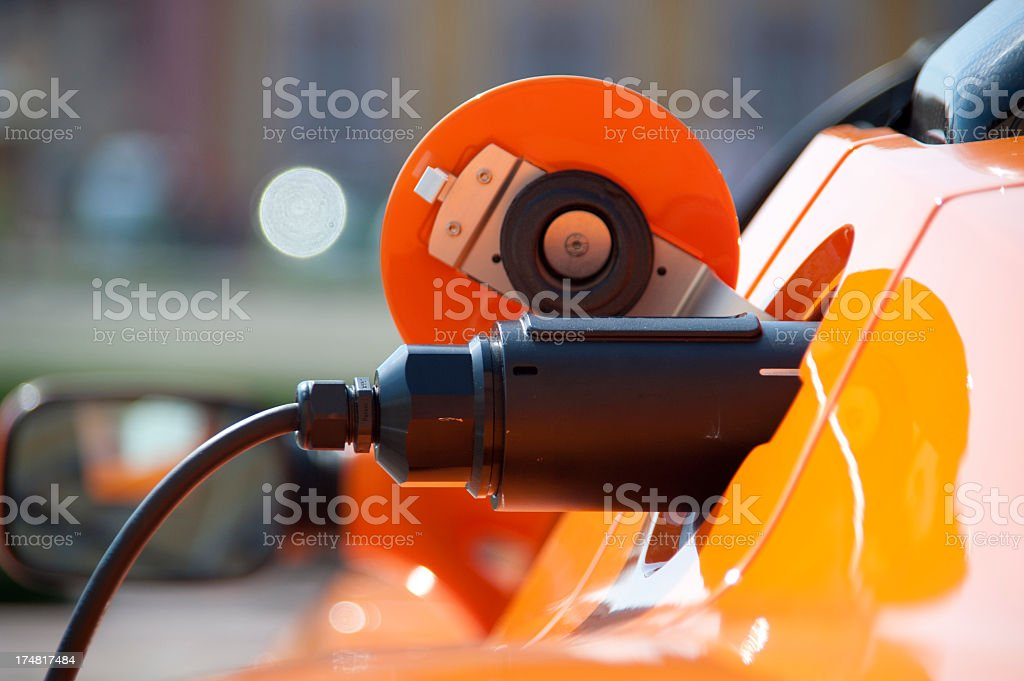 charge orange electric car stock photo