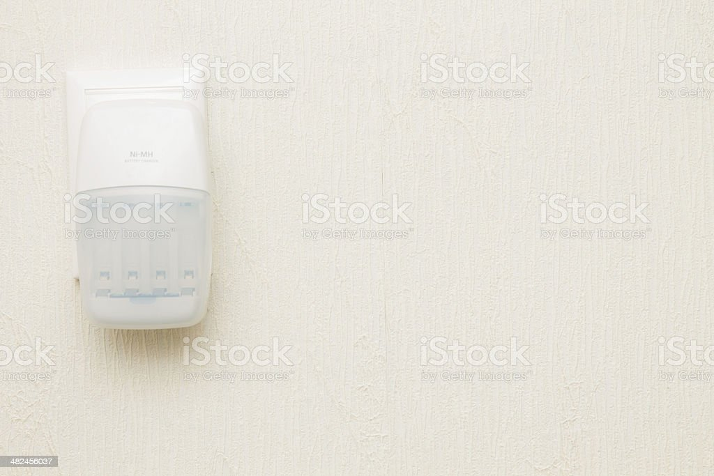 charger outlet left on wall royalty-free stock photo