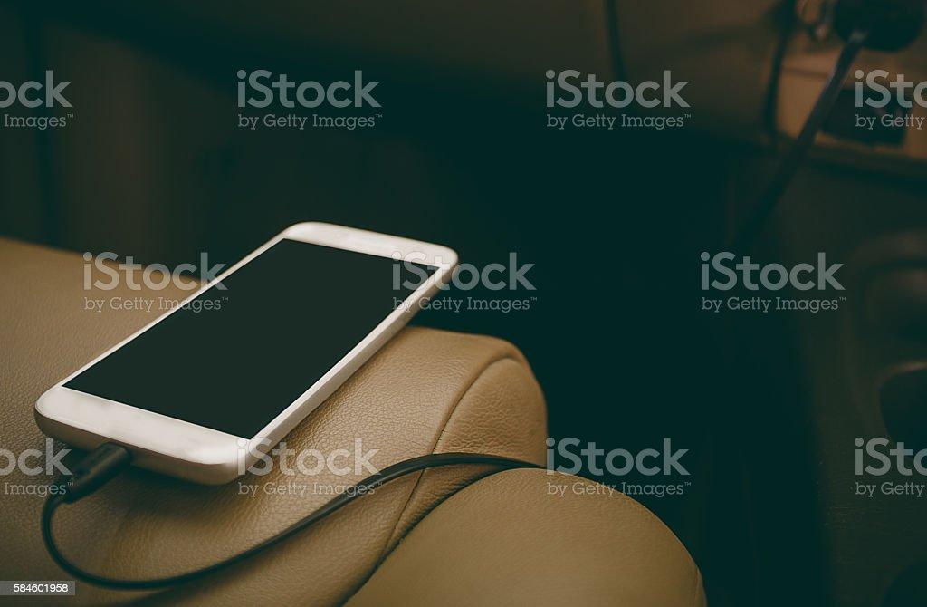Charger plug phone on car stock photo