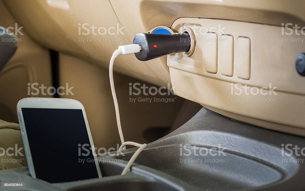 Charger plug phone on car stock photo