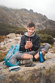 Charging a mobile phone on a mountain trail