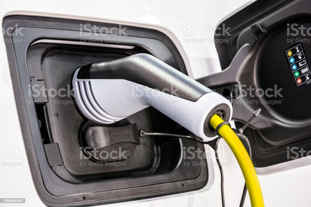 Charging battery of electric car stock photo