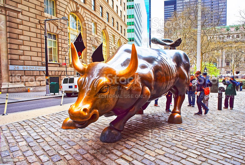 Charging Bull at Wall Street in Financial District stock photo