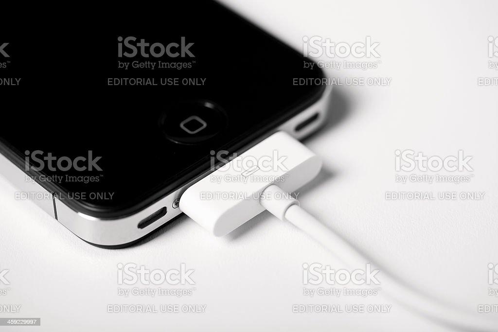 Charging iPhone 4 stock photo
