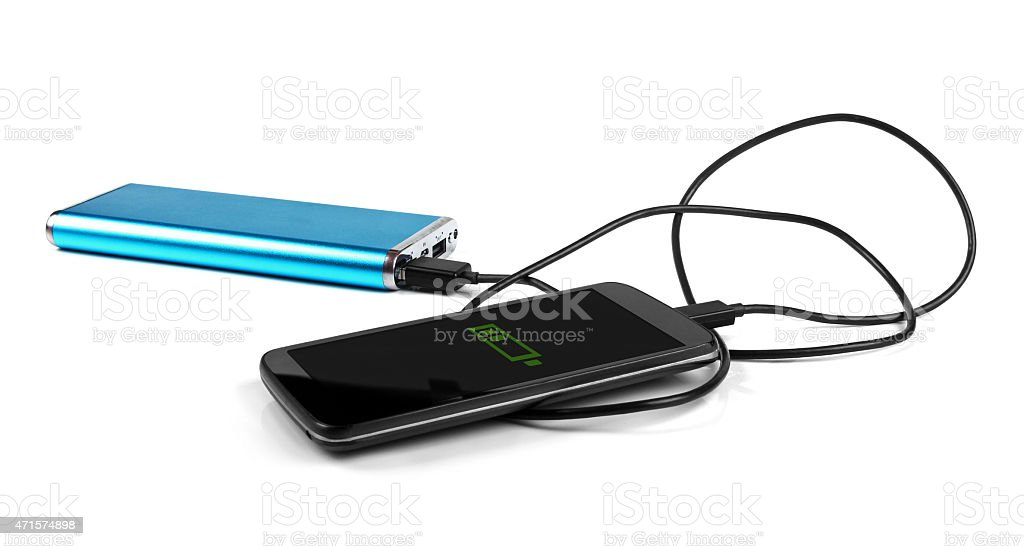 charging mobile phone with portable power bank stock photo