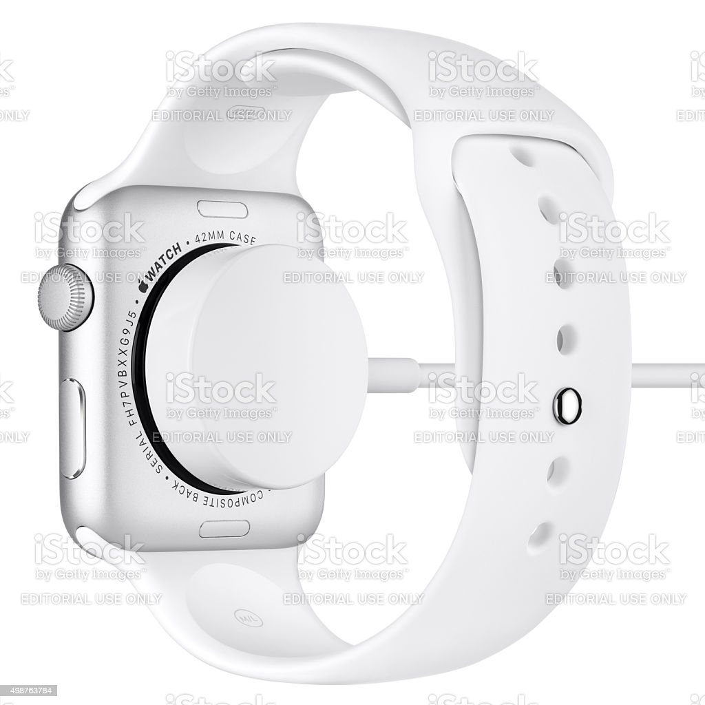Charging of Apple Watch Sport Silver Aluminum with White Band stock photo
