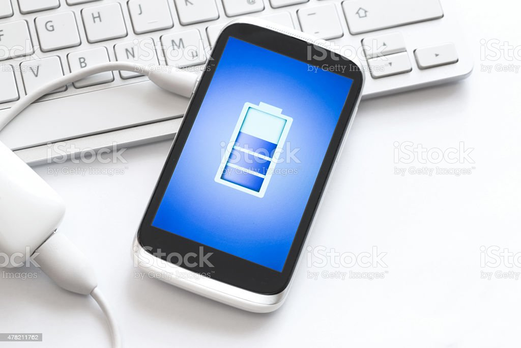 Charging of mobile phone. stock photo