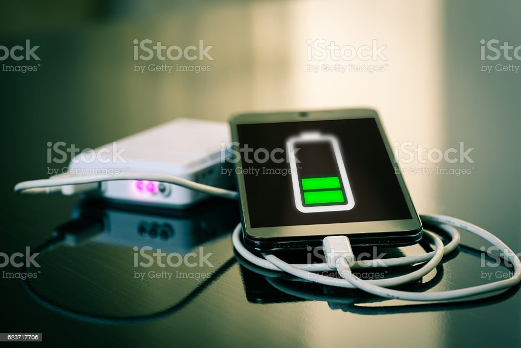 Charging of mobile smartphone stock photo