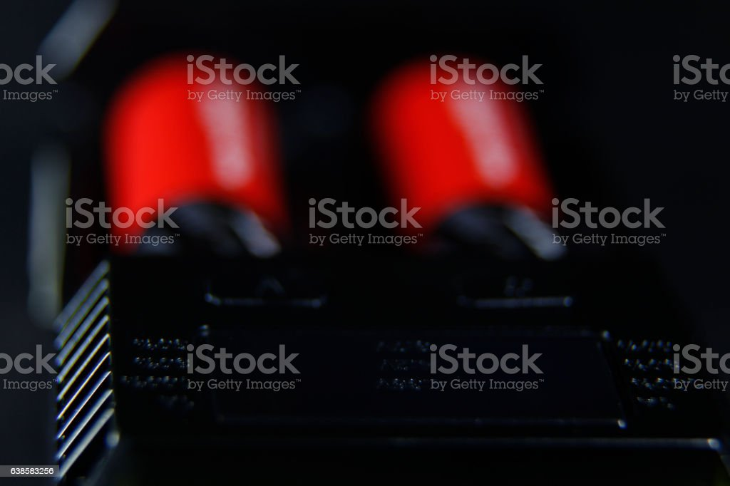 Charging of two batteries in the charger stock photo
