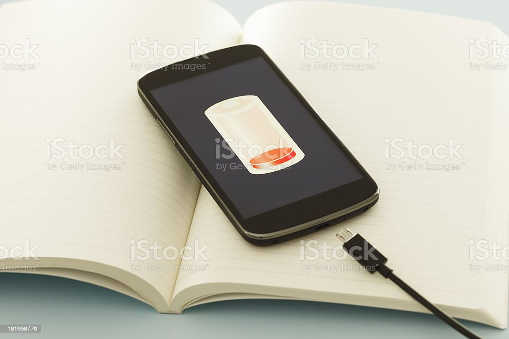 Charging smart phone stock photo