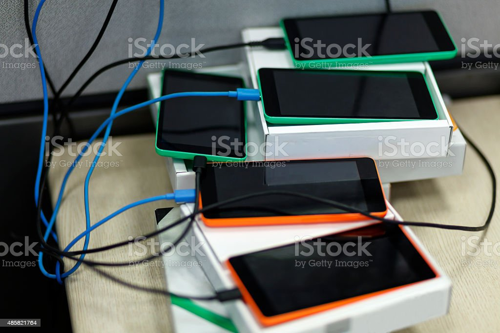 Charging Smart Phones stock photo