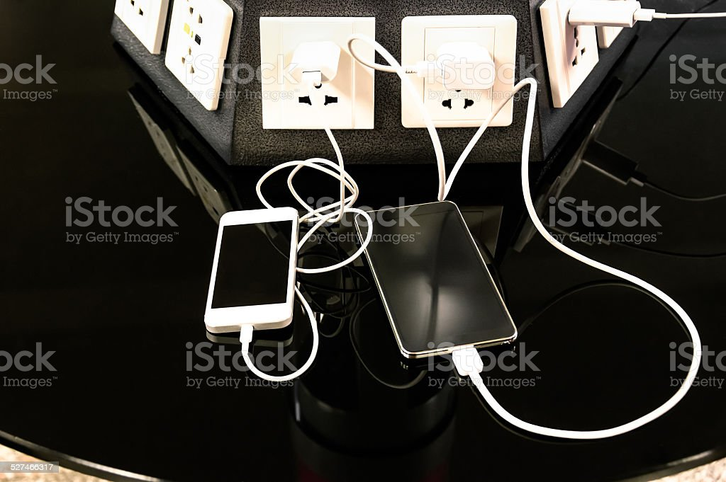 Charging station for mobile smart phones at airport stock photo