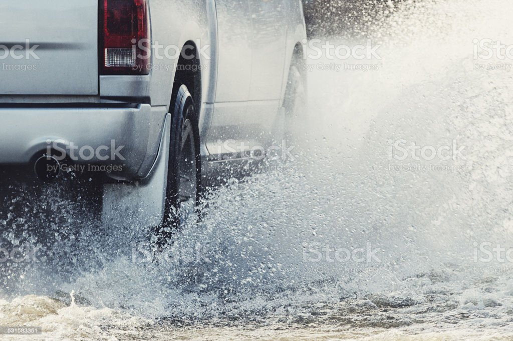 Charging Through Flood Waters stock photo
