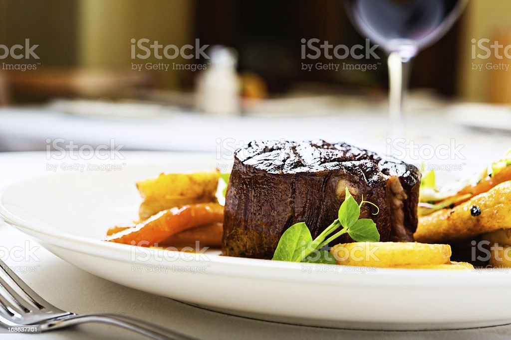 Char-grilled filet  mignon with glazed vegetables stock photo