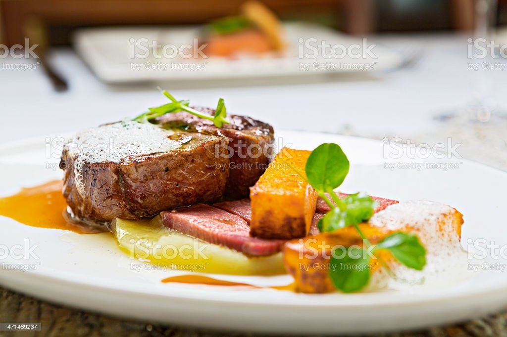 Char-grilled steak with unusual accompaniments in restaurant royalty-free stock photo