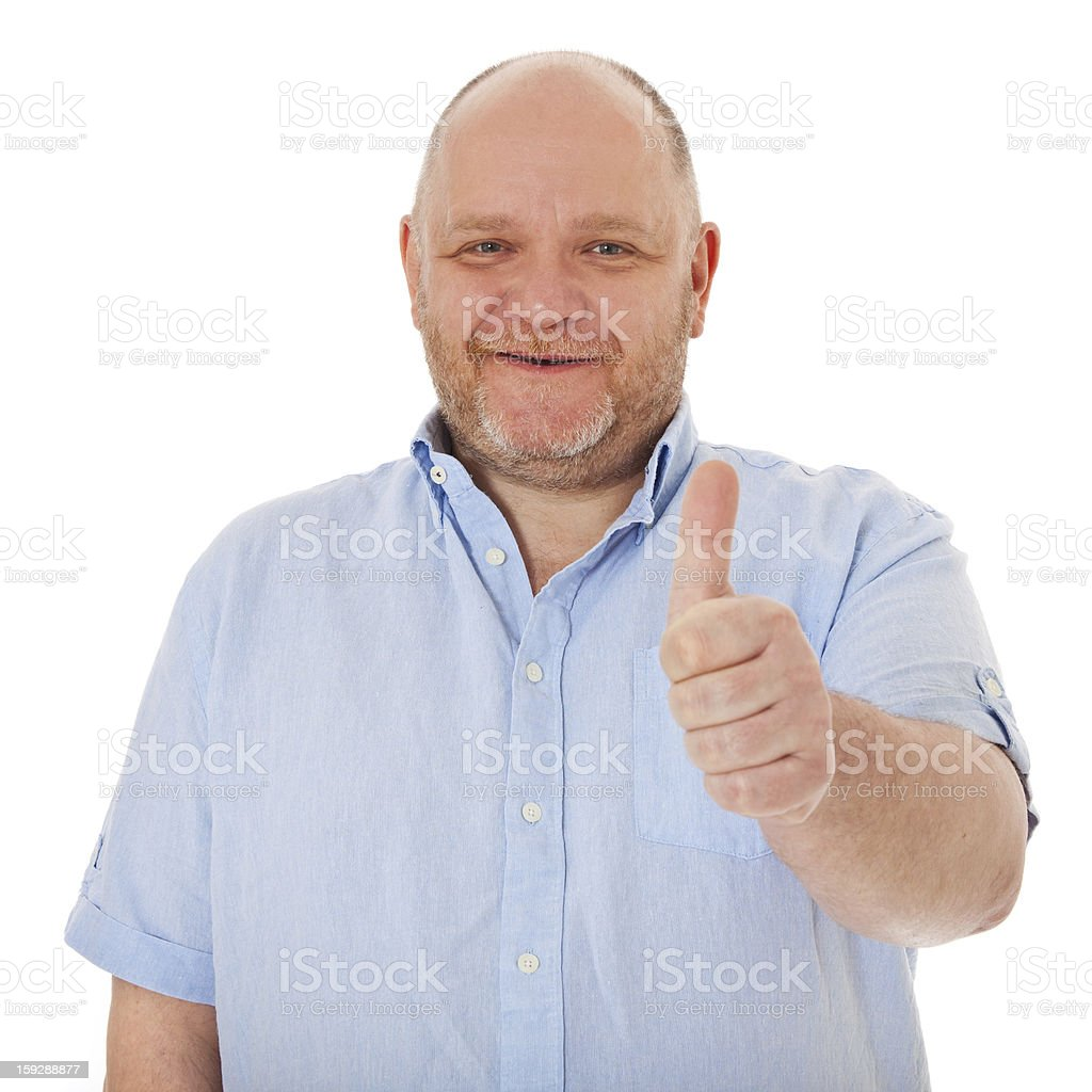 Charismatic adult man showing thumbs up royalty-free stock photo