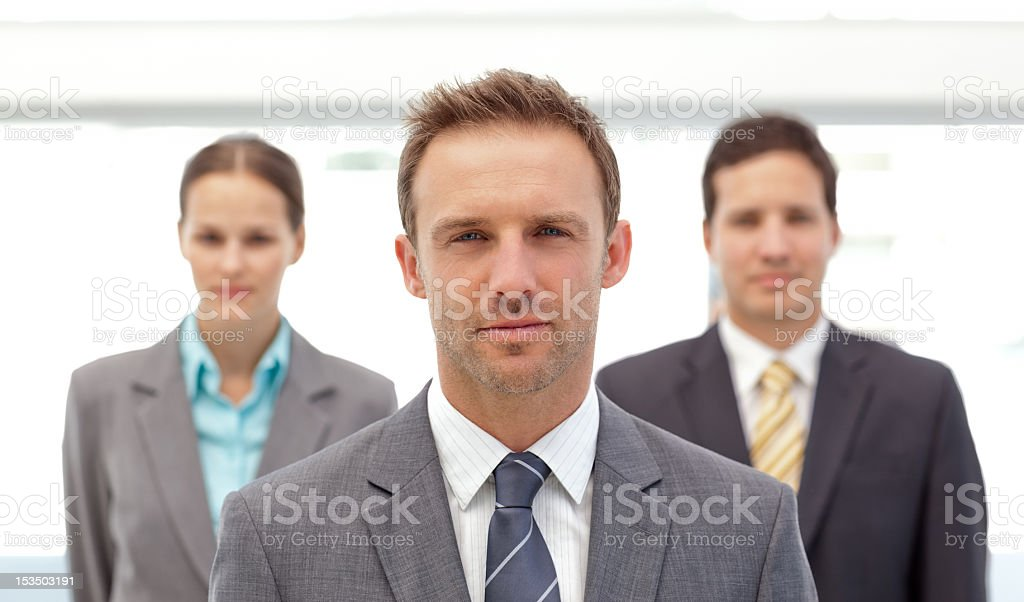 Charismatic manager posing in front of his employees royalty-free stock photo