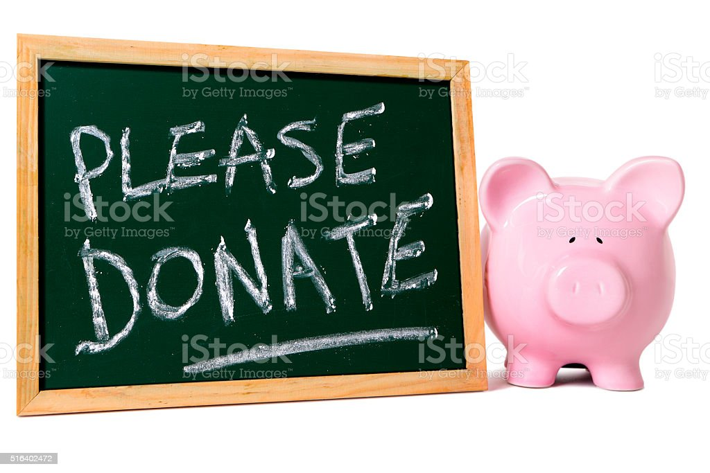 Charity donation box message, piggy bank stock photo