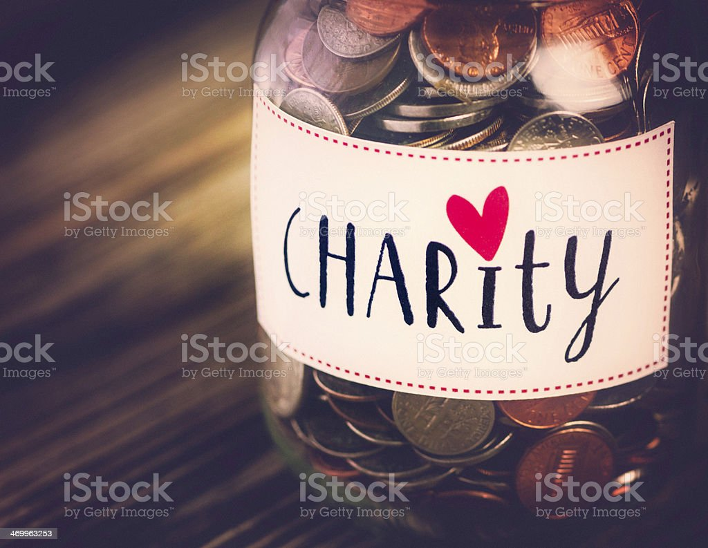 Charity Money Savings Jar stock photo