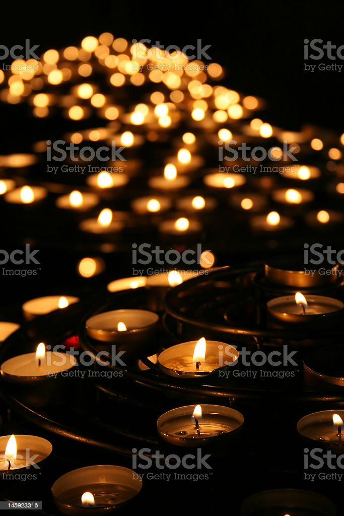 Charity. Praying candles in a temple. stock photo