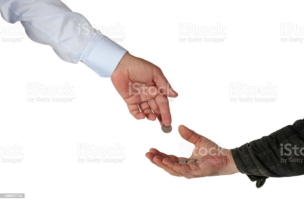 Charity. Rich submits alms to the poor man stock photo