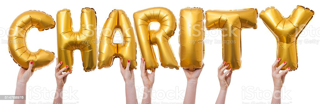 Charity word made from gold balloons stock photo