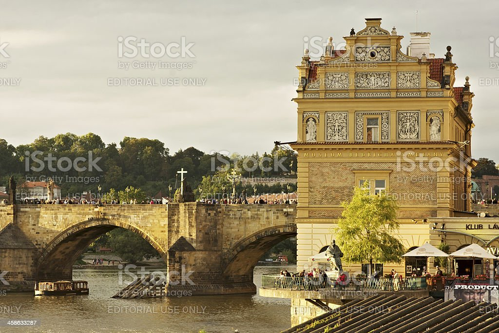 Charles Bridge and Bedřicha Smetany Museum at sunset royalty-free stock photo