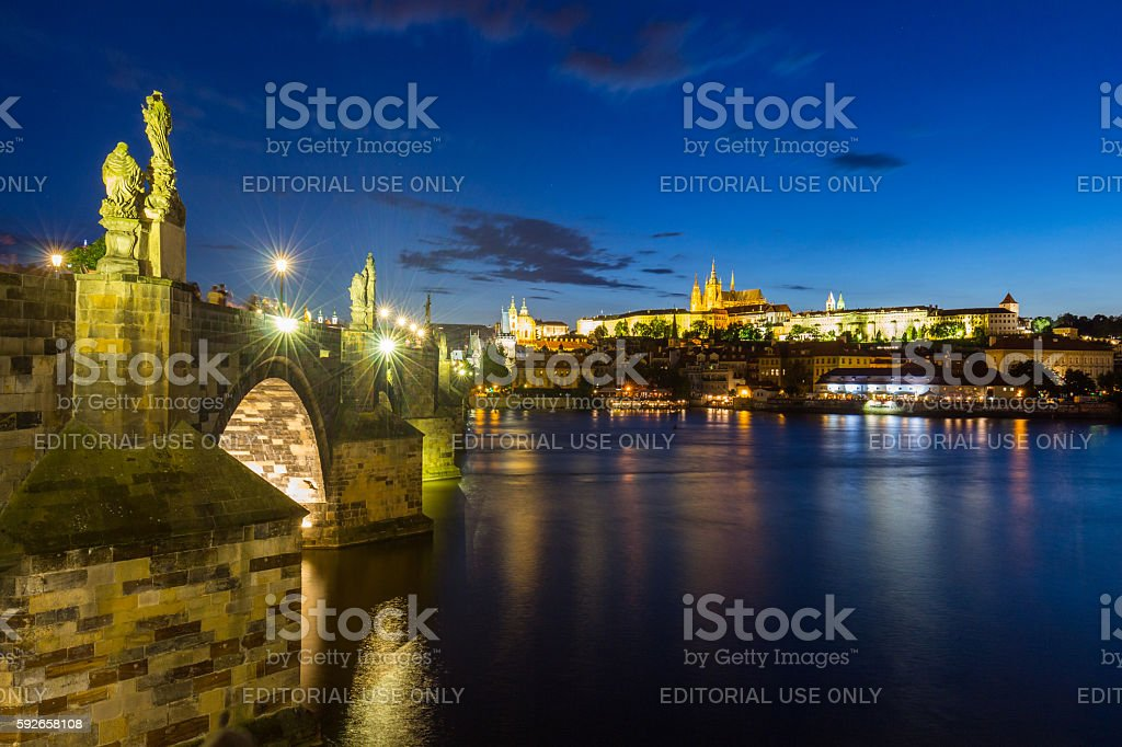Charles Bridge at night to the river. Czech Republic stock photo