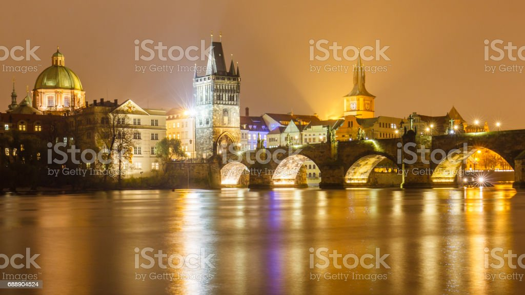 Charles bridge at night with water reflection, Prague, Czechia. stock photo