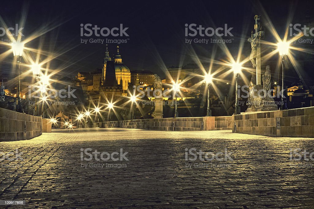 Charles bridge in Prague with lanterns royalty-free stock photo