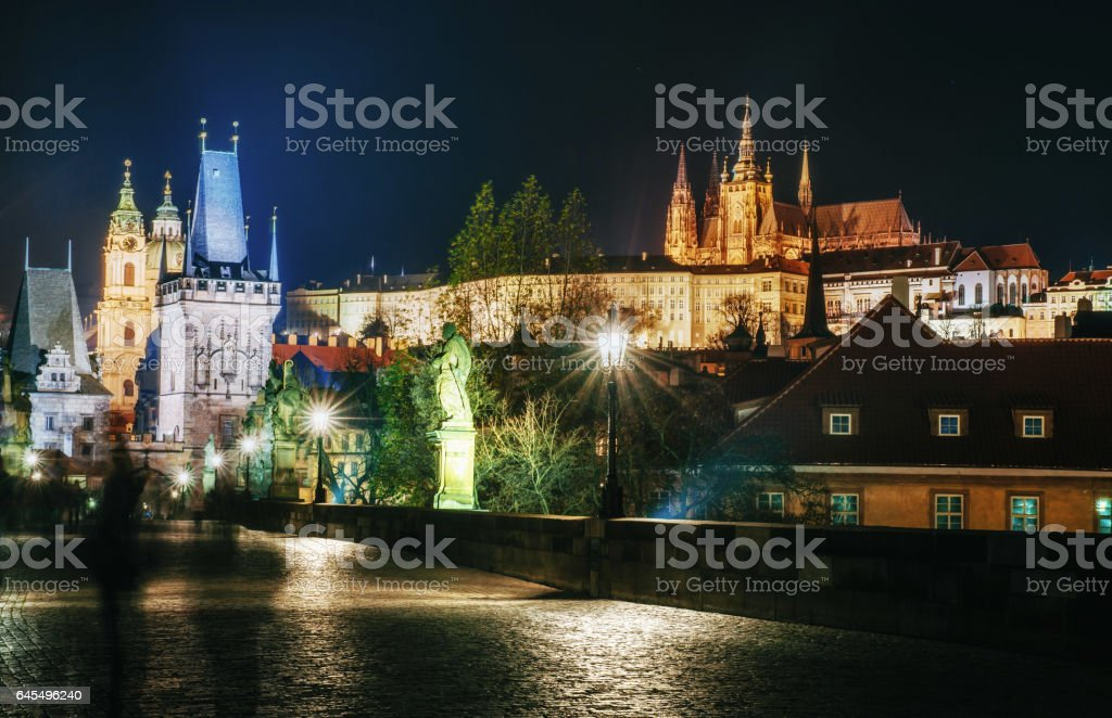 Charles Bridge with statues and Prague Castle at night. Beautiful urban lighting. , Czech Republic stock photo