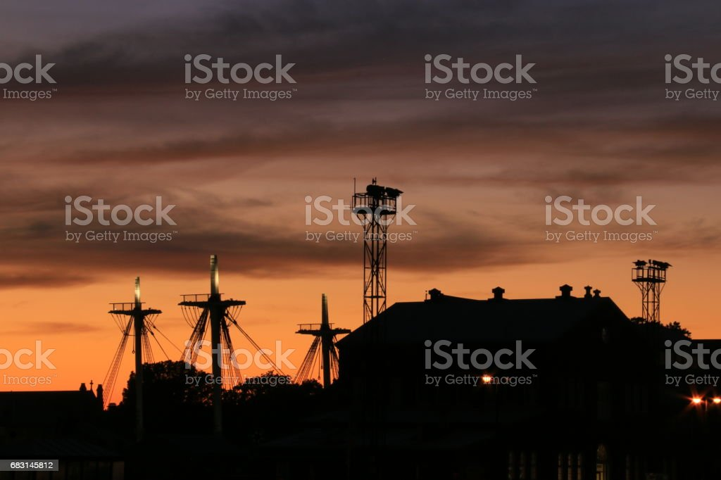 Charlestown harbor silhouettes at dusk stock photo