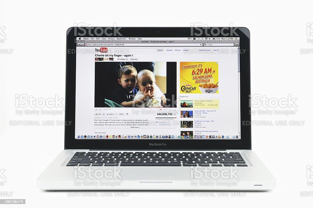 Charlie Bit My Finger on MacBook Pro stock photo