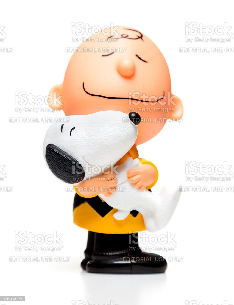 Charlie Brown hugging snoopy Happy Meal toy stock photo
