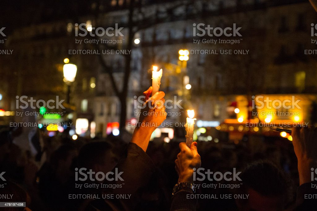 Charlie Hebdo - hand with candle royalty-free stock photo