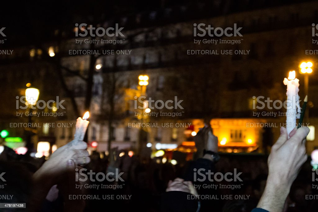 Charlie Hebdo - people with candles royalty-free stock photo
