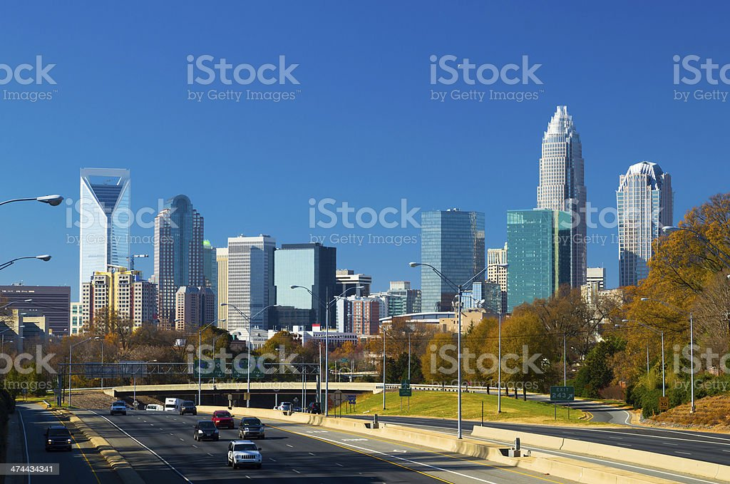 Charlotte downtown skyline and highway during Autumn stock photo