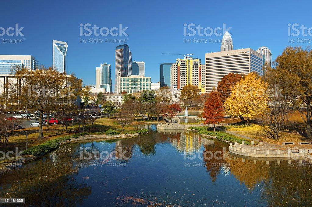 Charlotte skyline, park, and autumn trees stock photo