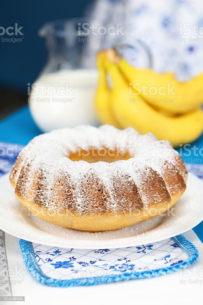 charlotte with powdered sugar and banana stock photo