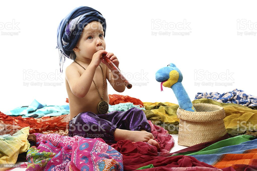 Charmer boy with pipe and snake royalty-free stock photo