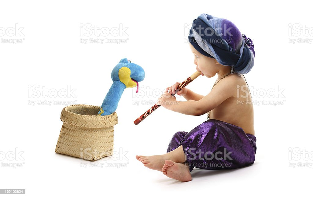 Charmer boy with pipe and snake stock photo
