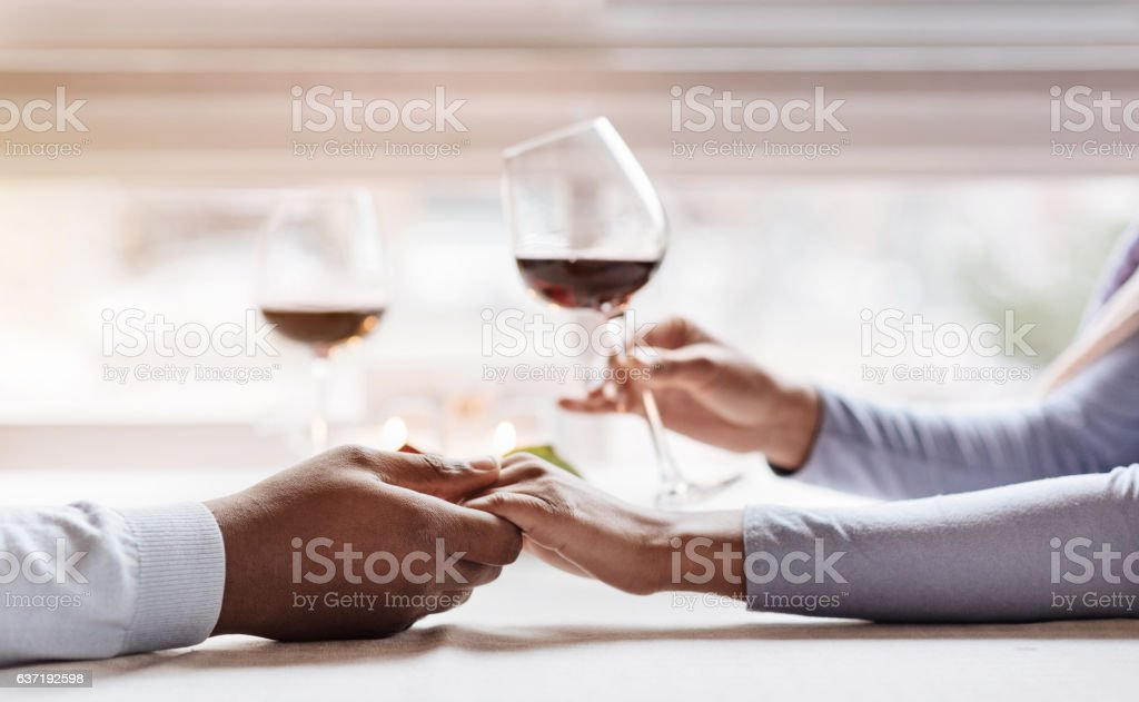Charming African American couple enjoying their time in the restaurant stock photo